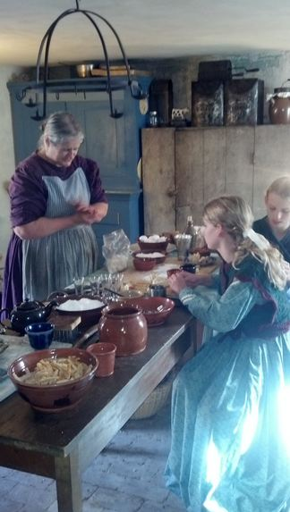 My girls forming marzipan, with historic foodways expert, Carol Anderson, on the left.