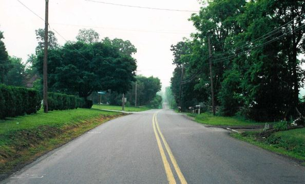 View of the modern road, in front of Graves Chapel, which follows the grade of the old turnpike.