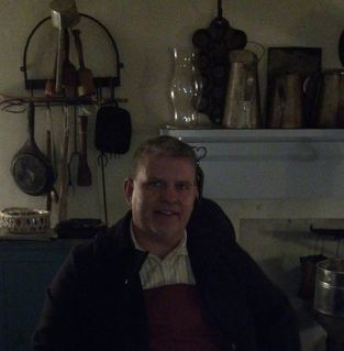 Me, sitting next to the wood cook stove, in the basement kitchen of Roeder's Confectionery.