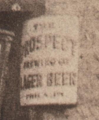 Close-up of the sign to the rear right of the C.C. Moore wagon.